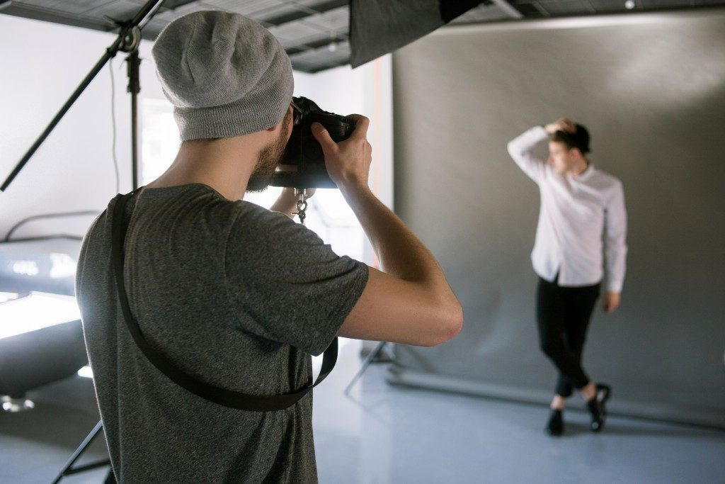 Man at a studio taking a photo
