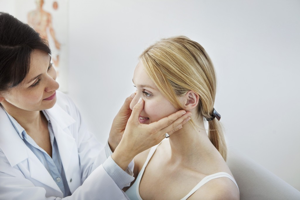Nose being checked by the doctor