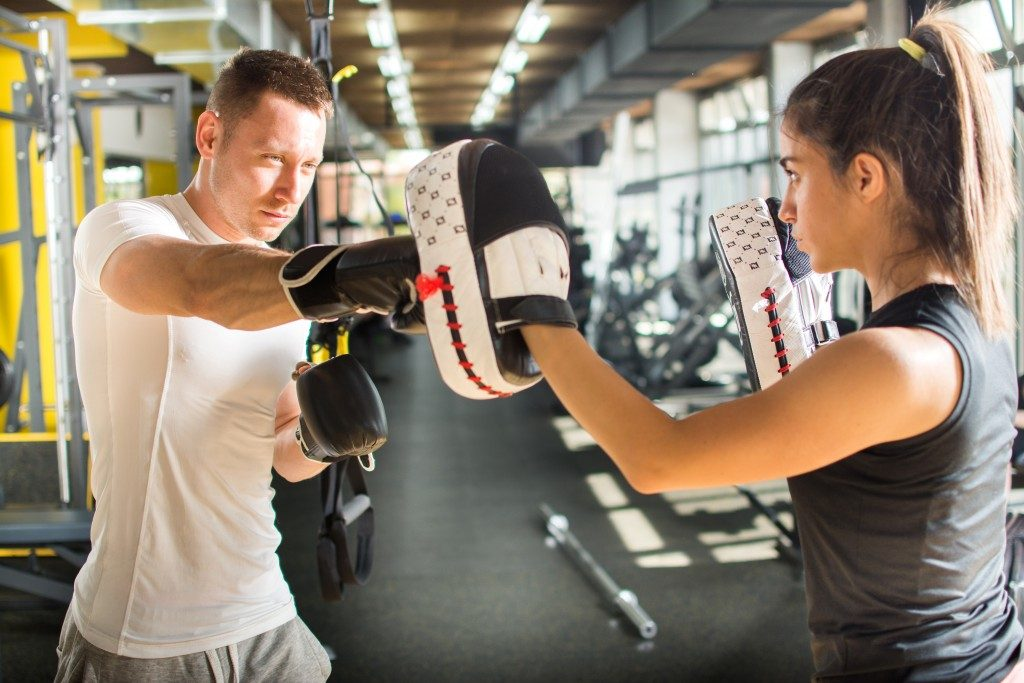 man and woman boxing training
