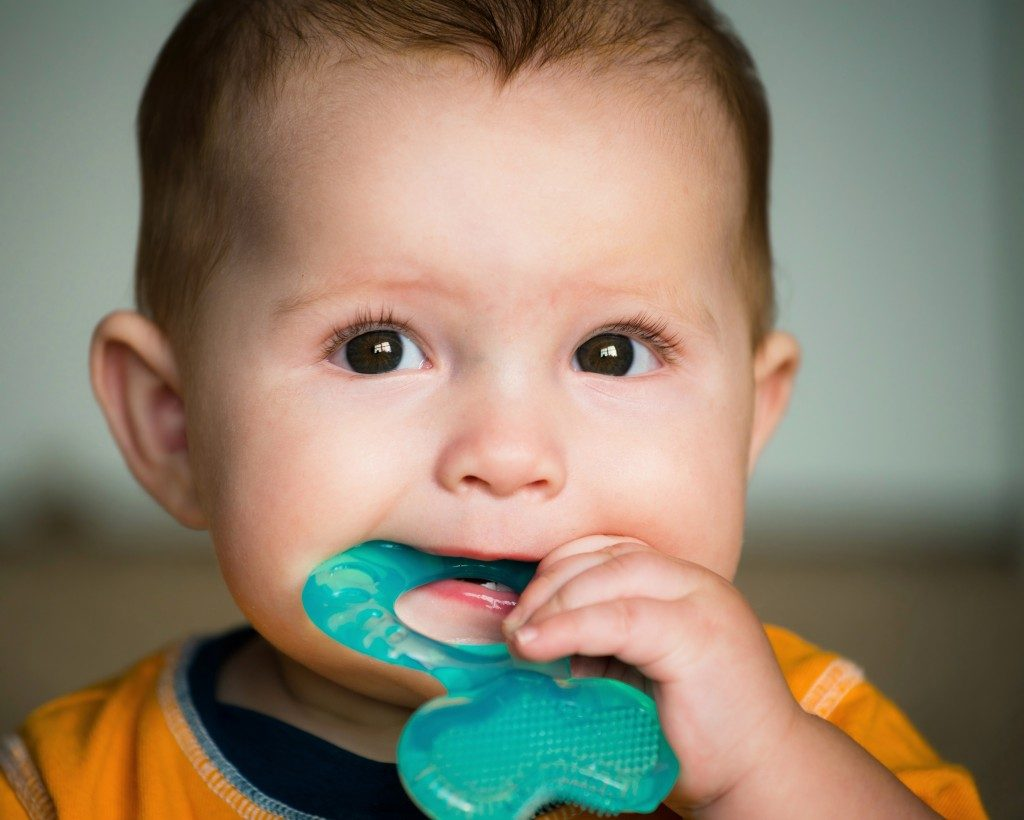 Baby chewing a teether
