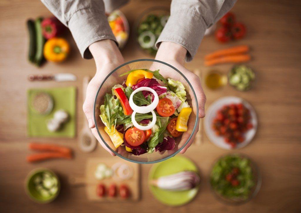 Fresh vegetarian salad on bowl