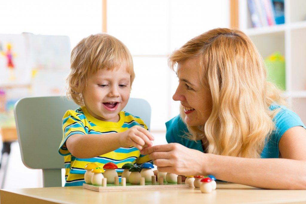 Child learning to count in a daycare