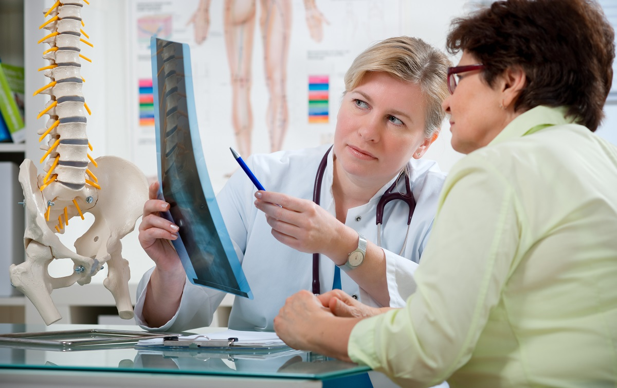 Doctor discussing the xray to the patient