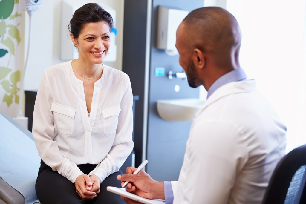 Woman consulting a male doctor