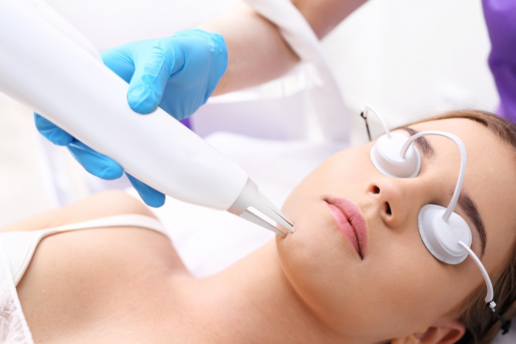 woman getting a laser treatment