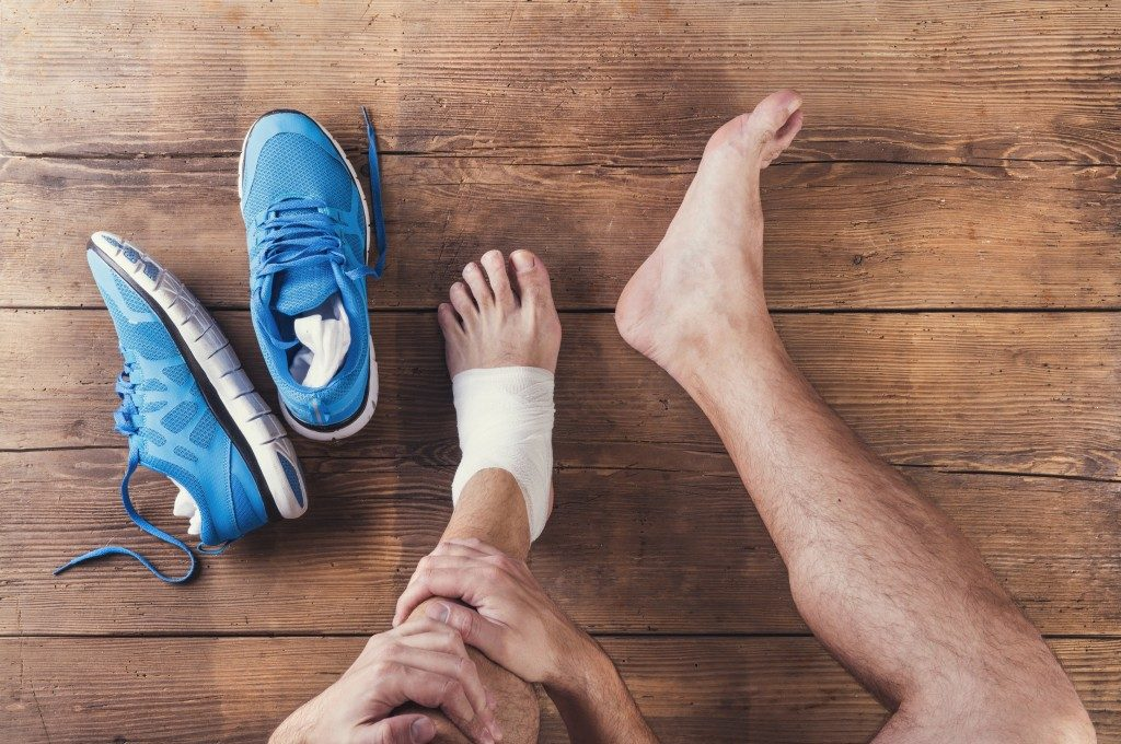 Man holding his leg with ankle sprain