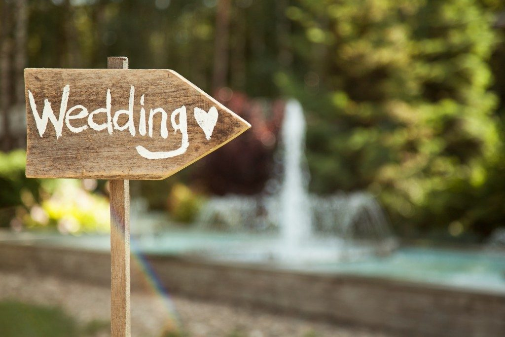 wooden plaque with wedding signage
