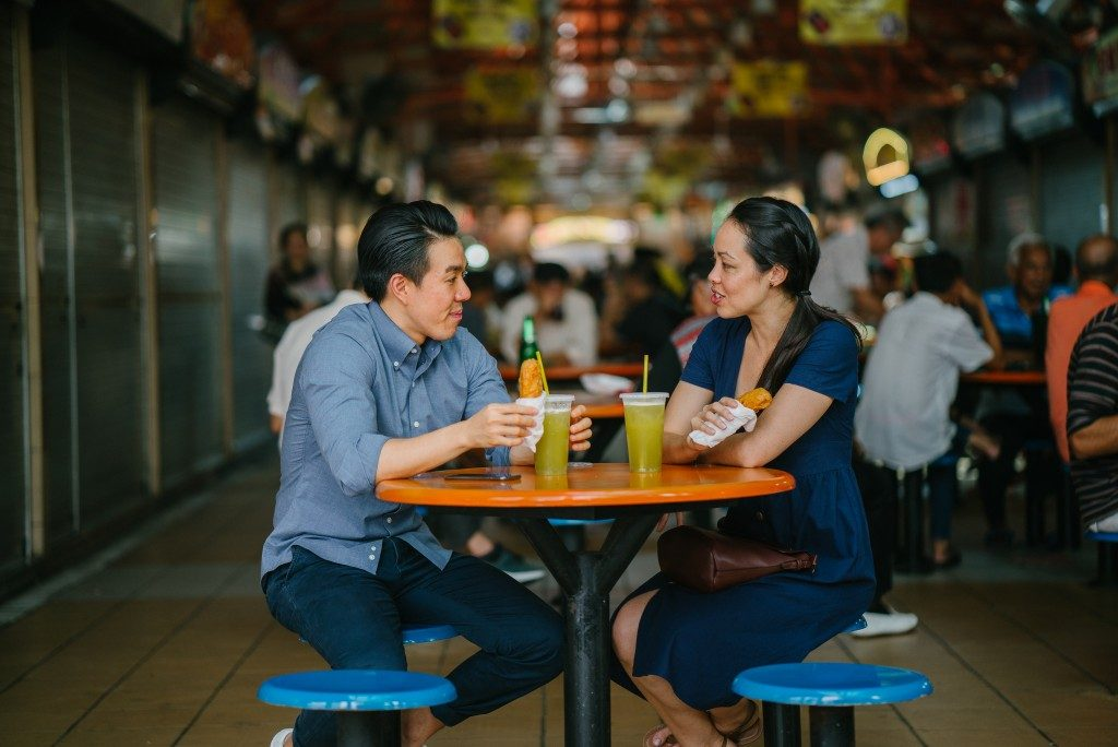 enjoying a snack at a hawker center