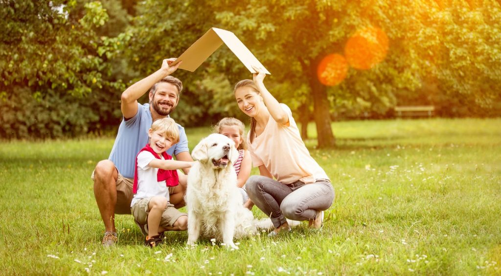 Family with their dog in new home concept