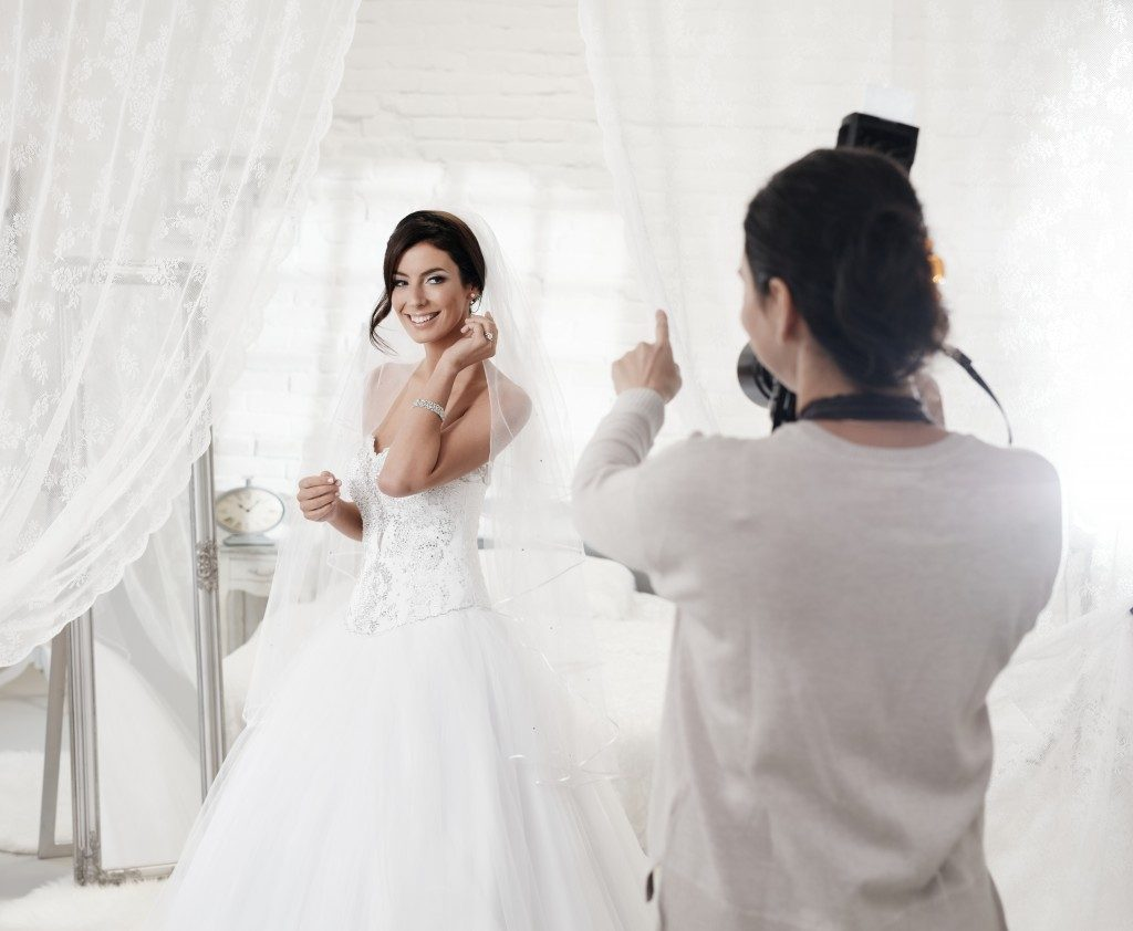 photographer shooting a bride