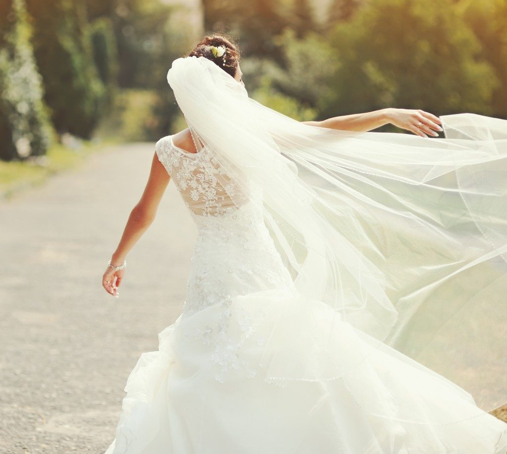 woman spinning in her wedding dress
