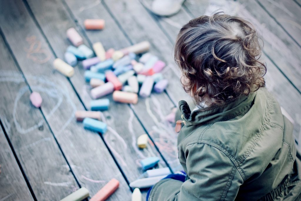 Boy playing with coloring materials
