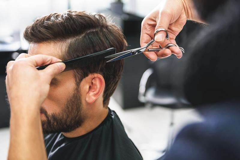 person having haircut