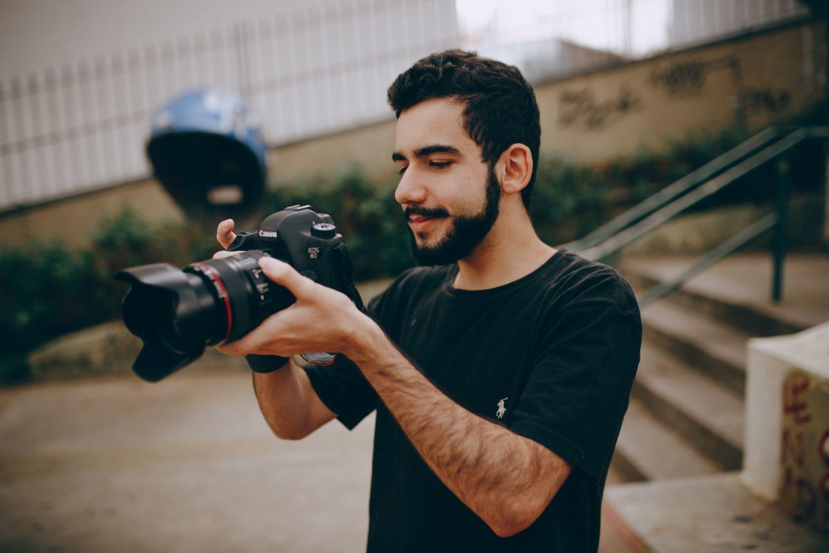 photographer looking at his camera