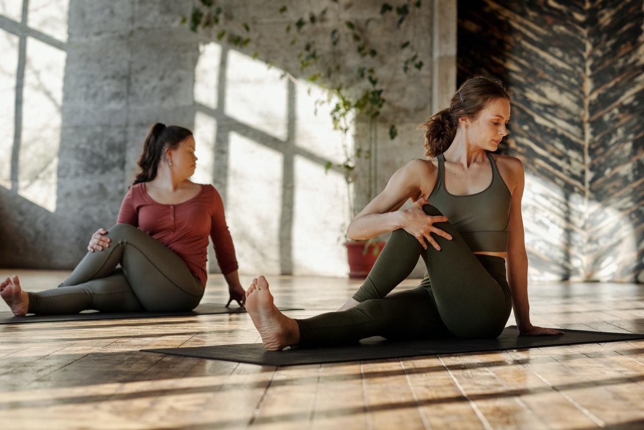 two women stretching doing yoga