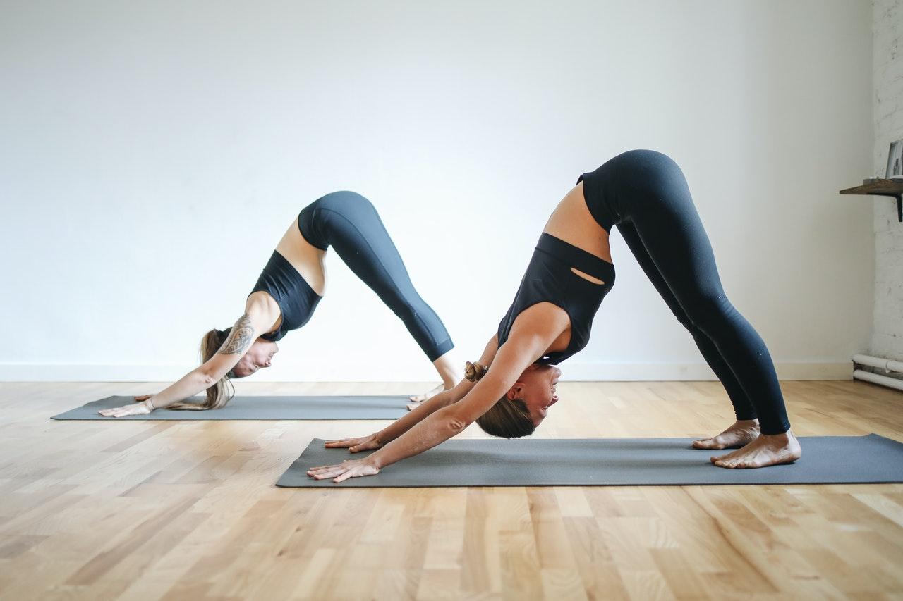 women stretching doing yoga poses