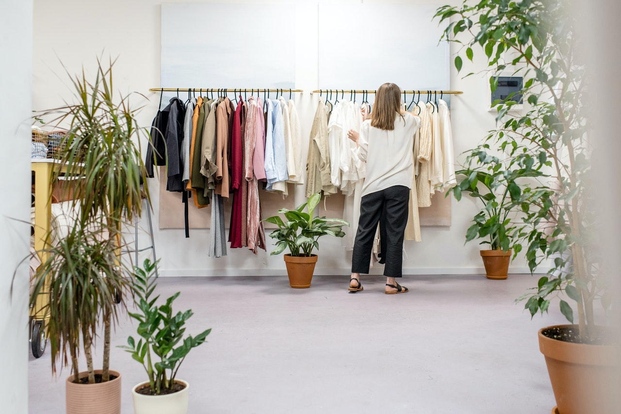 woman looking at clothes rack
