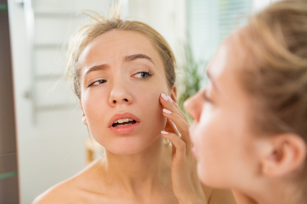 woman looking at her face