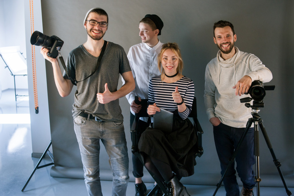 photographers smile in front of the camera